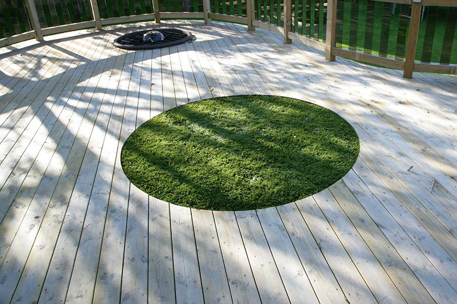 Grass cut into decking area