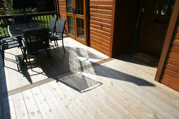 Grooved boards used for holiday home outdoor decking