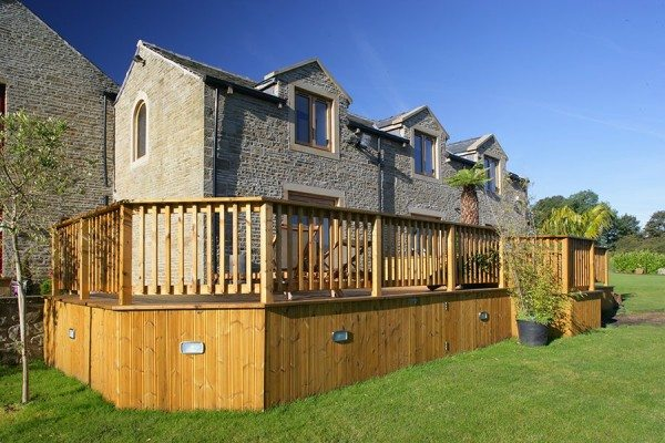 Raised timber decking with storage space below