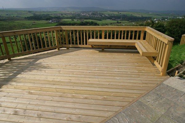 Decking area with a view on a sloping garden