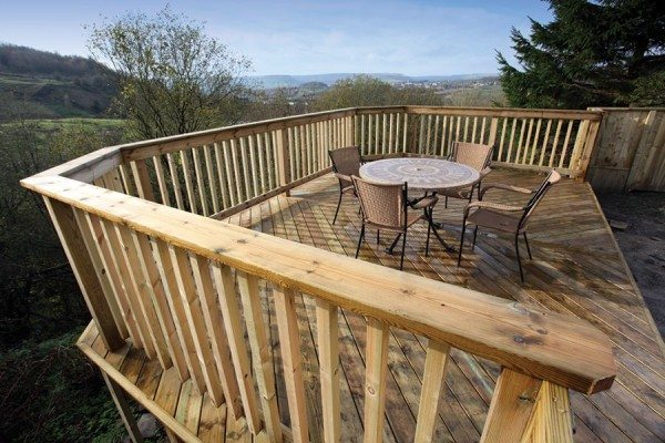 High timber deck on a sloping site