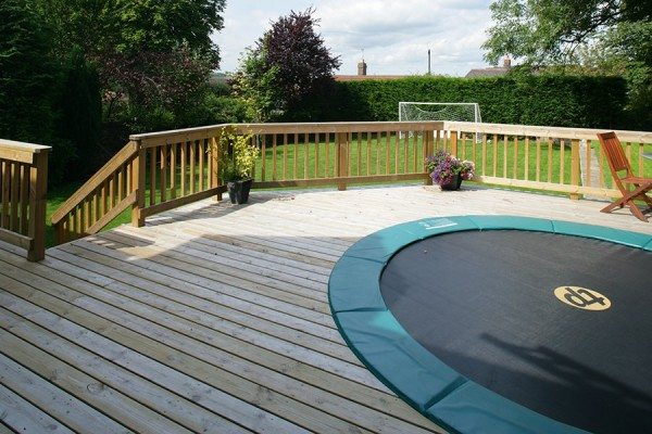 Trampoline incorporated within timber decking area