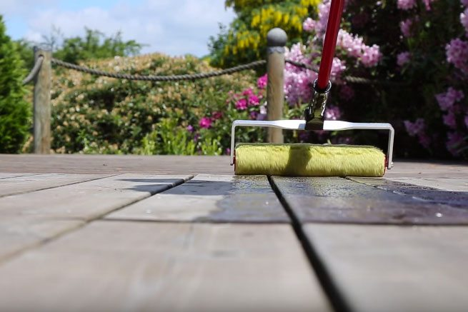 Applying treatment to timber deck