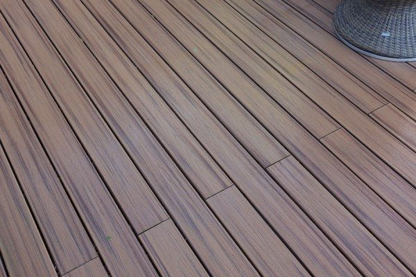 Close up of Trex Transcend composite decking in Spiced Rum