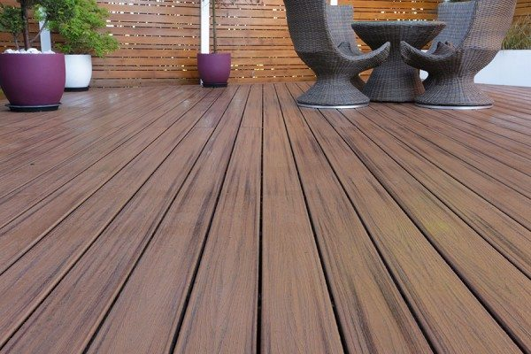 Dining area using Trex Transcend composite decking in Spiced Rum