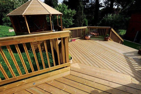 Decking on a sloping site creates more space to enjoy your garden