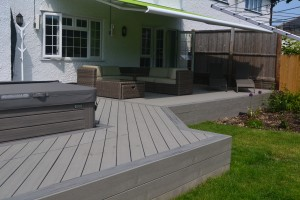 raised decking area with shaded seating area and spa