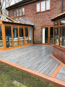 Decking with two conservatories