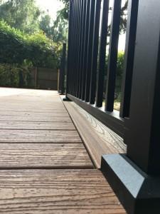 closeup of decking with metal railings
