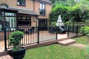 Large Trex deck with black railings