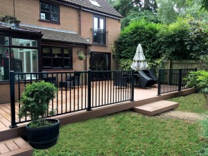 Large porch decking with metal railings