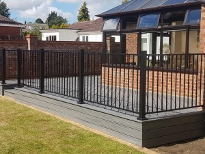 Raised porch decking with metal railings