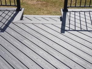Close up of decking steps with metal railings