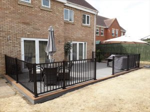 Large back garden decking with seating area and barbecue