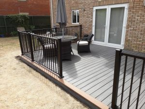 Large back garden decking with seating area and barbecue right view