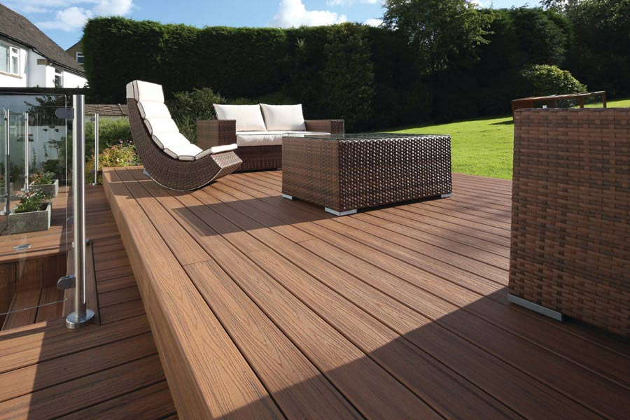 Trex decking with seats overlooking a large garden in summer