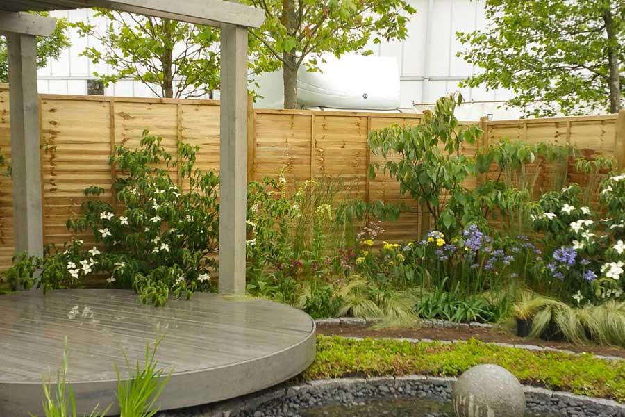 A pergola decking in a garden