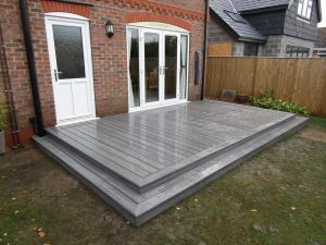 Rectangular Trex decking area in grey with step down