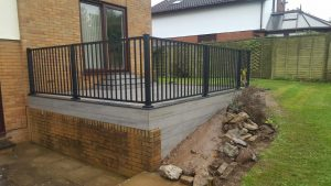 Trex deck with Aluminium railing outside of a rear house door