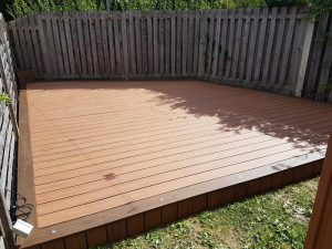 Enclosed decking surrounded by fencing