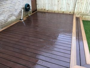Narrow decking with hose pipe and drainage pipe