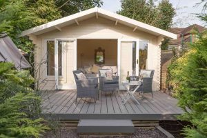 Small decking area with a summer house and seating area