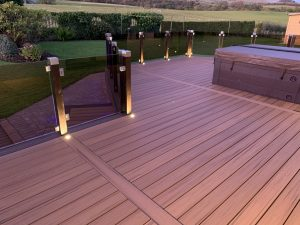 Trex deck with hot tub and spotlights