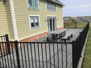 Trex® island mist decking with steel black railings close up left