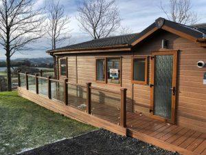 Brown Trex deck around Lodge