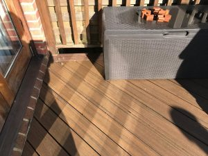 Decking patio in a back garden corner view