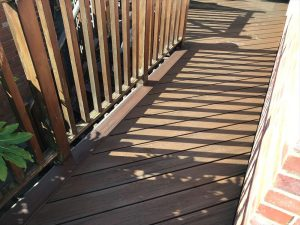 Decking patio in a back garden close up