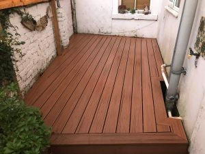 small enclosed area with lava rock decking