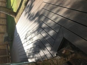 Hexagonal shaped decking in back garden above view