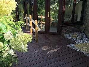 Brown Trex deck with gravel and handrail