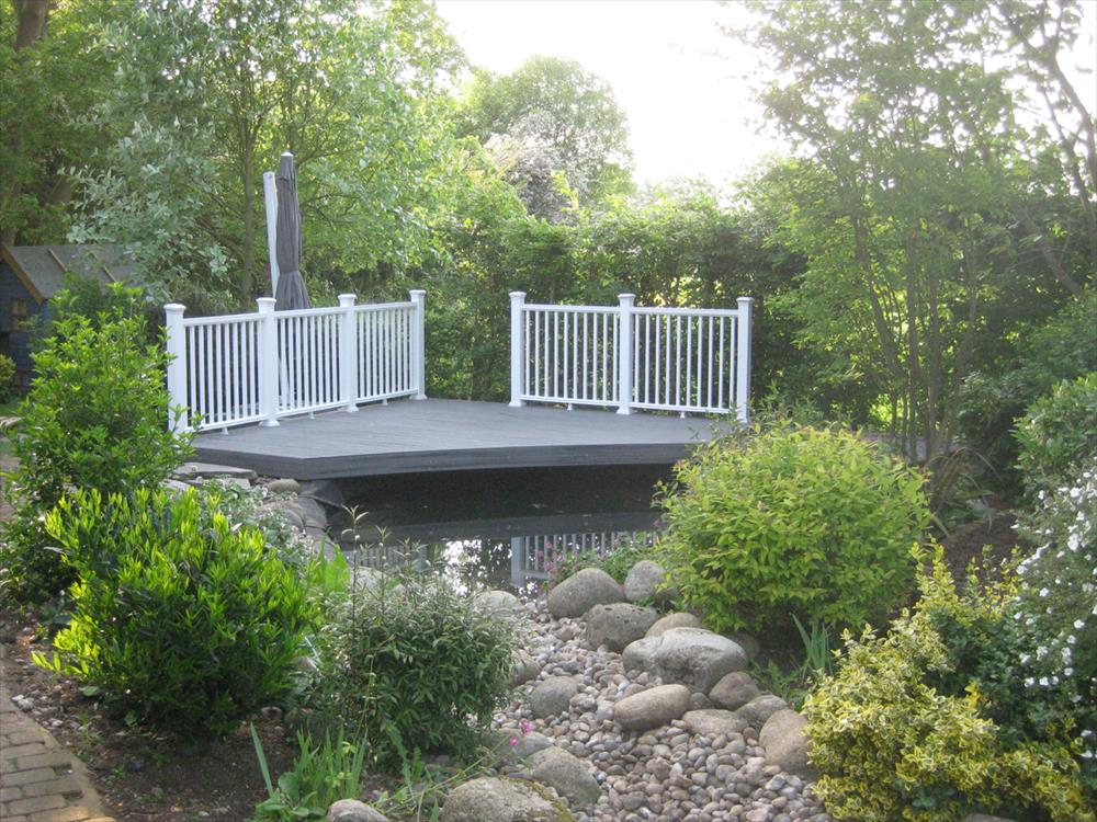 Small decking in island mist overlooking a pond