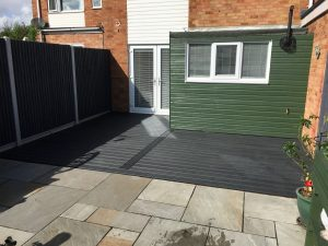 Black Trex deck with a green shed