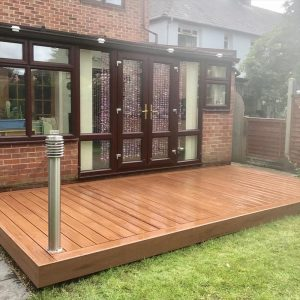 Small Saddle Trex® decking in back garden