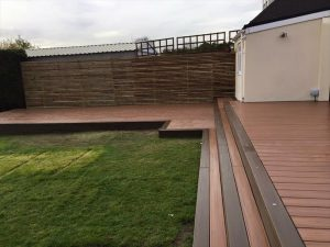 L-shaped toasted sand Trex® deck in a residential back garden