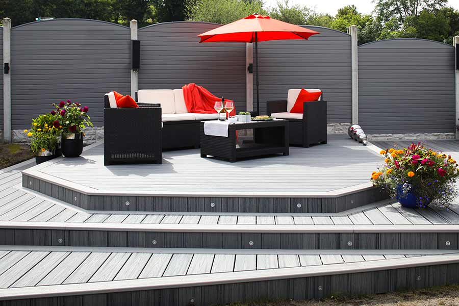 Red accessories used alongside the grey tones of Trex Island Mist decking
