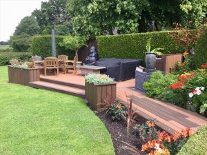 Large brown Trex deck with built-in planters