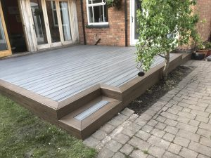Grey and brown Trex decking area