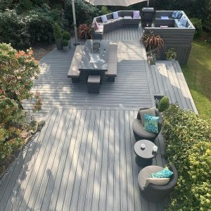 Large Trex Island Mist deck with dining table and seating area