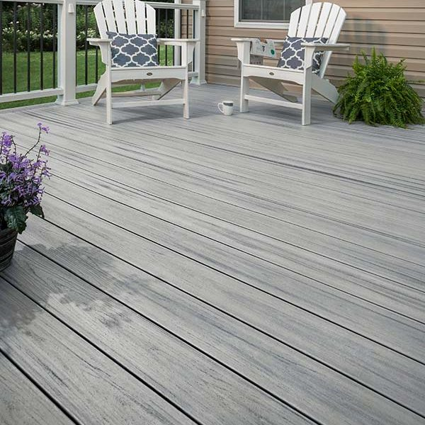 An outdoor garden of Trex enhance natural foggy wharf decking with chairs and plants.