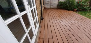 Brown Trex deck in front of house extension.