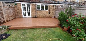 Brown Trex deck in front of house extension