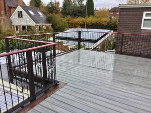 Trex deck with iron railing on a raised balcony