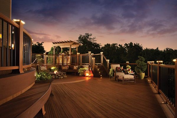 Trex deck living area at dusk, showing the range Trex outdoor lighting
