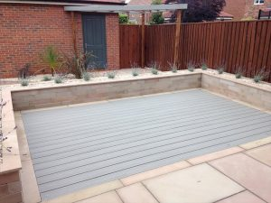 Trex deck surrounded by stone pavers