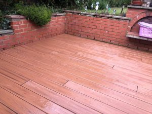 Brown deck after being rained on