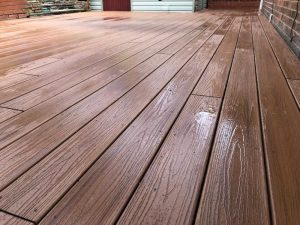 Up close view of an installed trex deck after being rained on